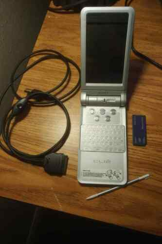 Sony Clie PDA PEG-NX60 with stylus, memory stick, USB charger.  works great
