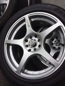 4 summer tires with mag235/45/17  (4x114.3)(4x100)
