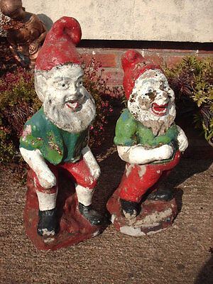 TWO VINTAGE CAST STONE GARDEN GNOMES / STATUES