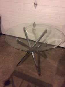 Glass dining table and almost new chairs
