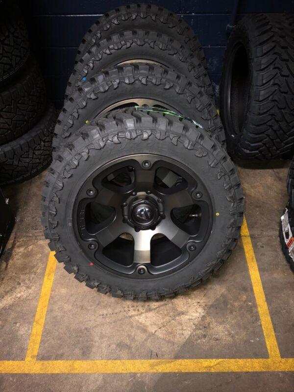 """20x10 Fuel Beast D564 Wheels Rims 35"""" Atturo Mt Tires 5x5.5 Ram 1500"""