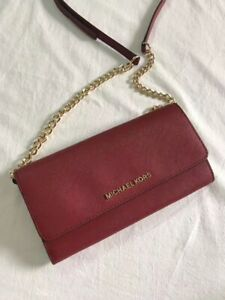 Brand new Micheal Kors cross body wallet