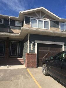 New townhome in east end with attached garage for rent