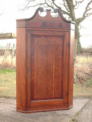 ANTIQUE OAK & MAHOGANY CORNER CUPBOARD WITH SWAN NECK PEDIMENT