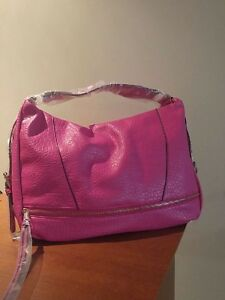 Brand new faux leather bag in hot pink.