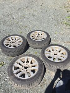 Four barely used 205/55/16 Winter Tires with Rims