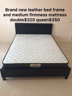 Brand new leather bed frame with medium firm mattress D$320,Q$350