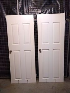 Two white wooden doors with handles and hinges Hurstville Hurstville Area Preview
