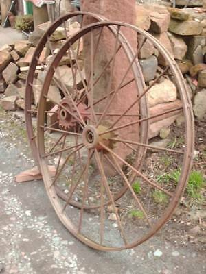 LARGE PAIR OF ANTIQUE RUSTIC IRON WHEELS