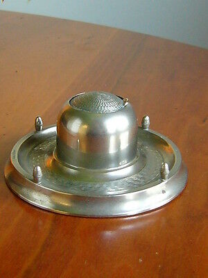 AN UNUSUAL ART DECO ENGINE TURNED METAL ROLL TOP INKWELL