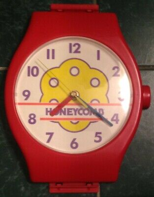 VINTAGE QUARTZ HONEYCOMB CEREAL CLOCK w/out band - not working - sold for parts