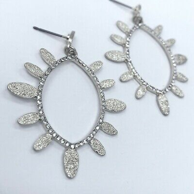- Silver Finish Oval Shape Hollow Clear Rhinestones Hammered Dangle Metal Earrings