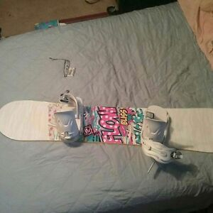 Woman's flow snowboard with bindings.