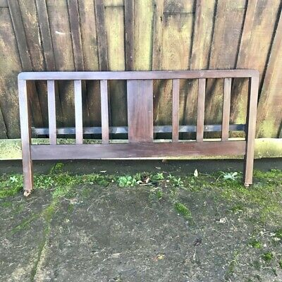 Edwardian mahogany plain double bed foot end with metal brackets with castors