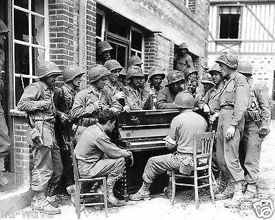 "Soldiers of the 2nd Armored Division sing ""Go to town"" in Barenton, France 1944"