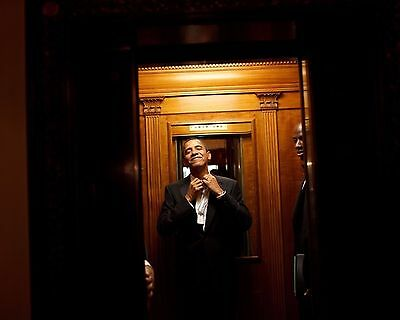 President Barack Obama rides in an elevator at the White House Photo Print