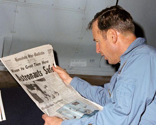 JIM LOVELL READS NEWSPAPER AFTER APOLLO 13 SPLASHDOWN - 8X10 NASA PHOTO (EP-647)