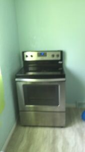Stainless whirlpool fridge and stove    It's been  sold