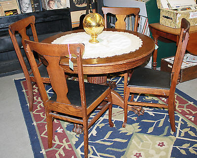 Antique Round Oak Claw Foot Table with 4 Chairs on Rummage