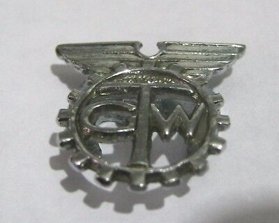 Fantastic silver tone metal badge marked GTW approx ¾ ins wide