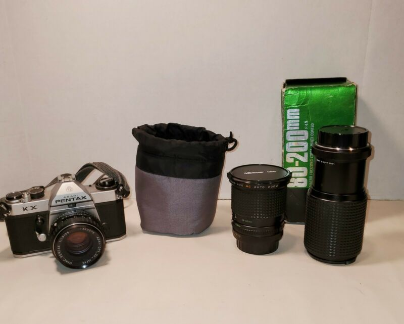 Asahi Pentax KX 35mm SLR Film Camera with carrying case and extra lenses.
