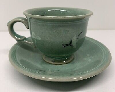Set of 2 attractive Midcentury  ceramic cup and saucers in a light brow-ocher colour glazing.