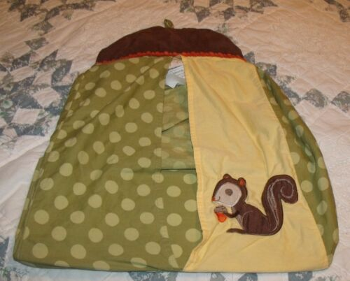 diaper stacker green circles yellow with a squirrel