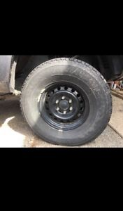 265/70R16 Firestone tires on rims