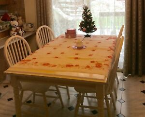 White kitchen table. Hardwood, good quality. No chairs