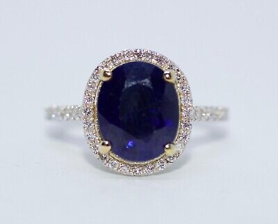 18k White Gold Oval Blue Sapphire With A Halo Of Round Diamonds Ring Size 6.5