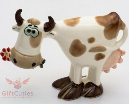 Porcelain Figurine of Cow with the flower