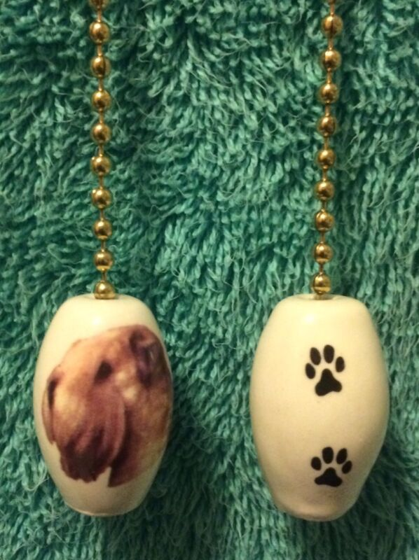 One Wheaton Terrier Fan Pull With Paw Prints On The Bach 1-inch