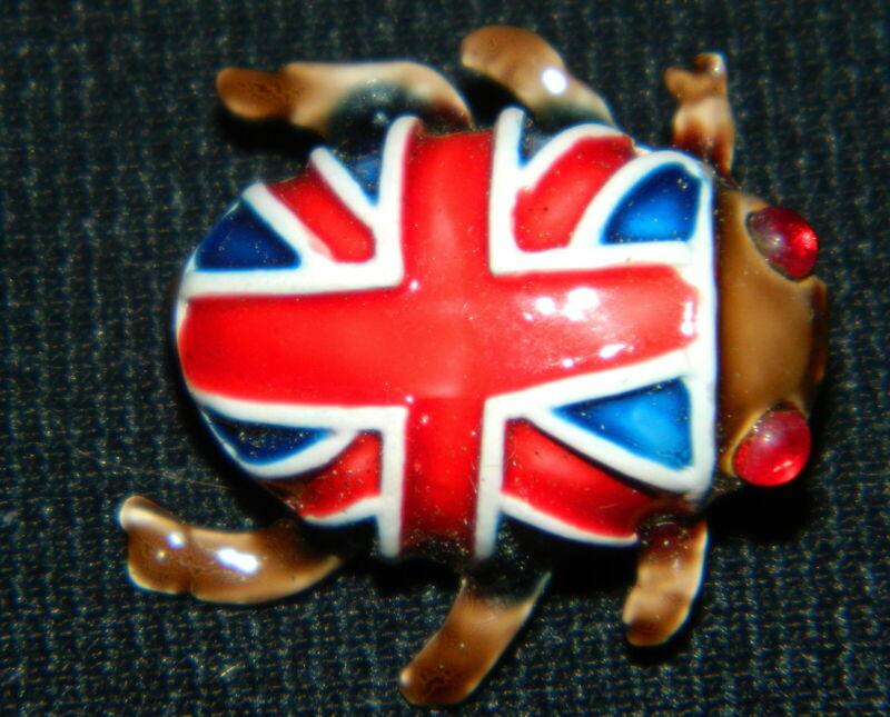 179#C-- Brooch Bug British Flag Enameled Ruby Eye Vintage