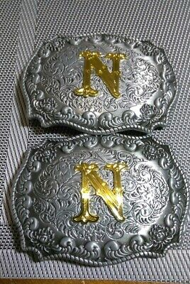2 BELT BUCKLES WITH THE LETTER