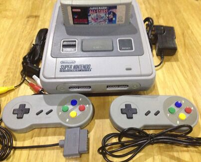 Super Nintendo Console with 4 Games
