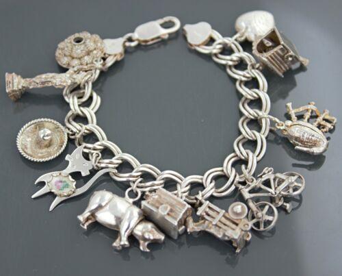 Vintage Sterling Silver 11 Charms Bracelet 44.30 grams