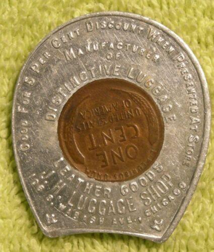 1922 D J.H. Luggage Shop encased cent Chicago
