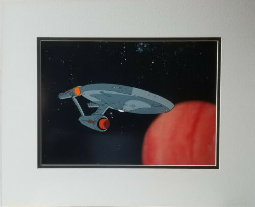 Star Trek Animation Cel with the Enterprise Starship Rounding a Planet