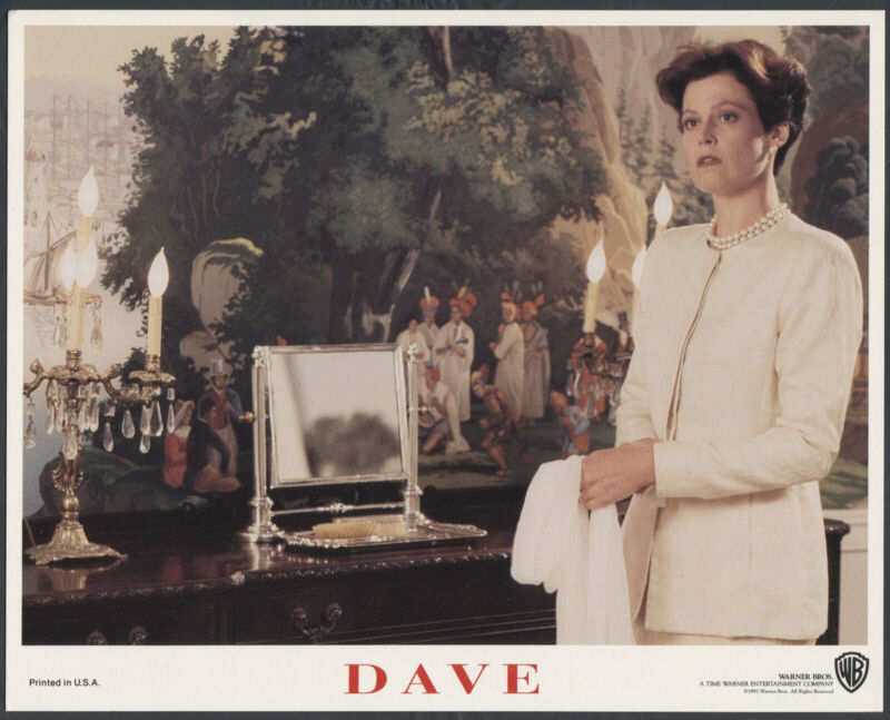 SIGOURNEY WEAVER STANDING NEAR A TAPESTRY Dave '93