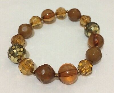 Lovely elasticated gold and brown tone plastic beaded bracelet