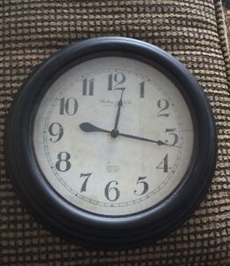 Dark brown wall clock