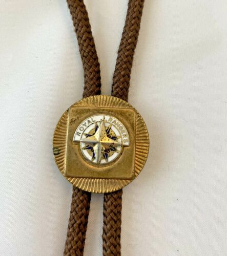 Royal Rangers Bolo Tie Gold Tone w/White and Blue BackGround Brown Cord