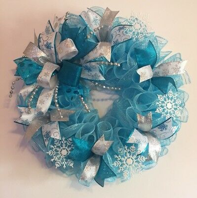 """21"""" Handmade Winter Deco Mesh Snowflake Wreath With Bow - Light Blue & Silver"""