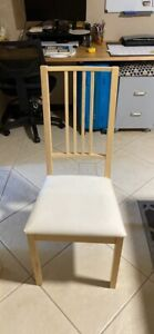 2 Used white timber dining chairs