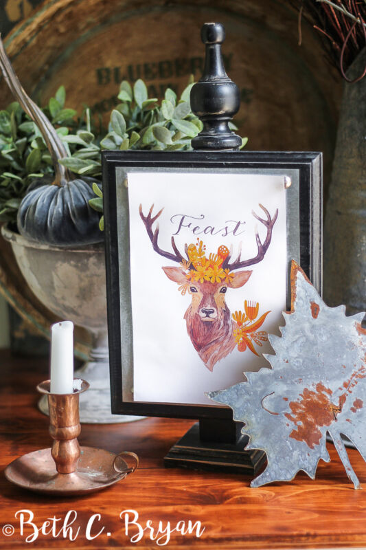 'Feast' deer printable with galvanized maple leaf and a vintage copper candlestick holder.