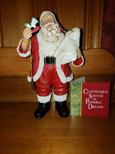 Santa Claus figure holding a baby, made in 1994 by Possible Dreams