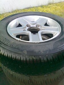 205/75R15/97T All Season Tires on Rims