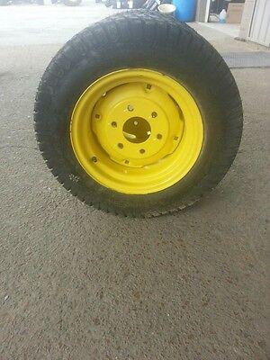 Two 258.50x14 Carlisle John Deere 4 Ply Turf Tires On John Deere 6 Hole Wheels