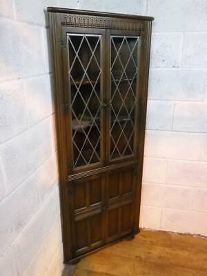 PRIORY OAK CORNER DISPLAY CABINET, LEADED GLAZED UPPER DOOR.
