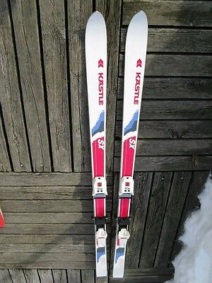 (Kastle SX450 downhill skis, Marker bindings, and Kastle poles, Raichle boots)